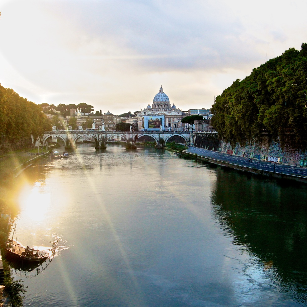 Sunset over Saint Peter and Tiber in Rome